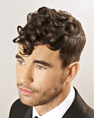 a medium brown curly top shaved sides hairstylepierre