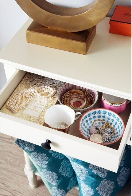 Vintage teacups in a drawer make for perfect and pretty jewellery storage.