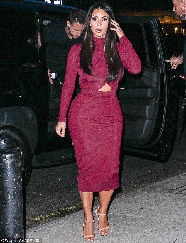 453694691fea Revealing in red  Kim Kardashian showed off her curves in a sexy maroon  dress as she stepped out for dinner in New York on Monday night