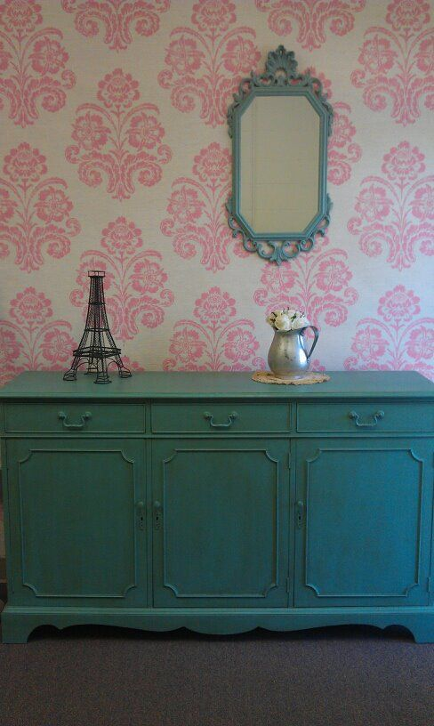 Wallpaper with a staple gun. Great idea for rentals!
