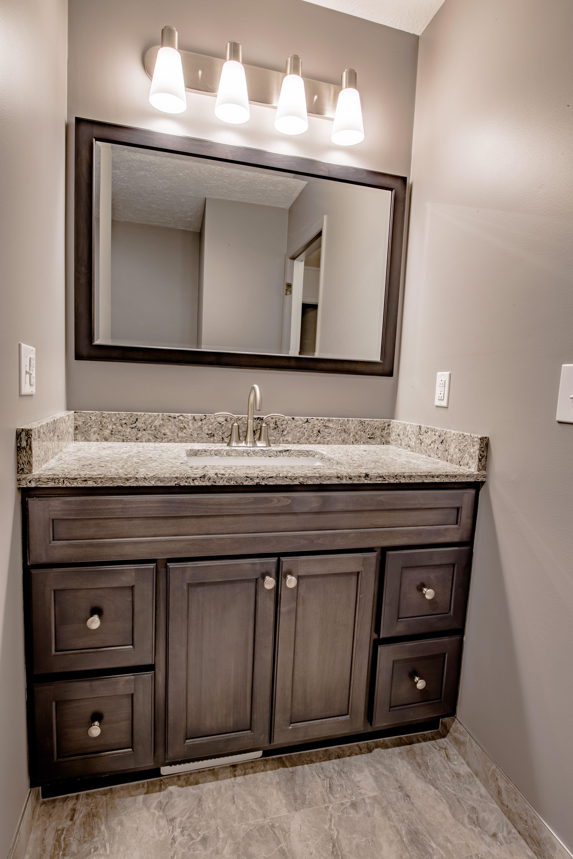 Re Bath Omaha Remodels Include Custom Bertch Vanities Dark Wood