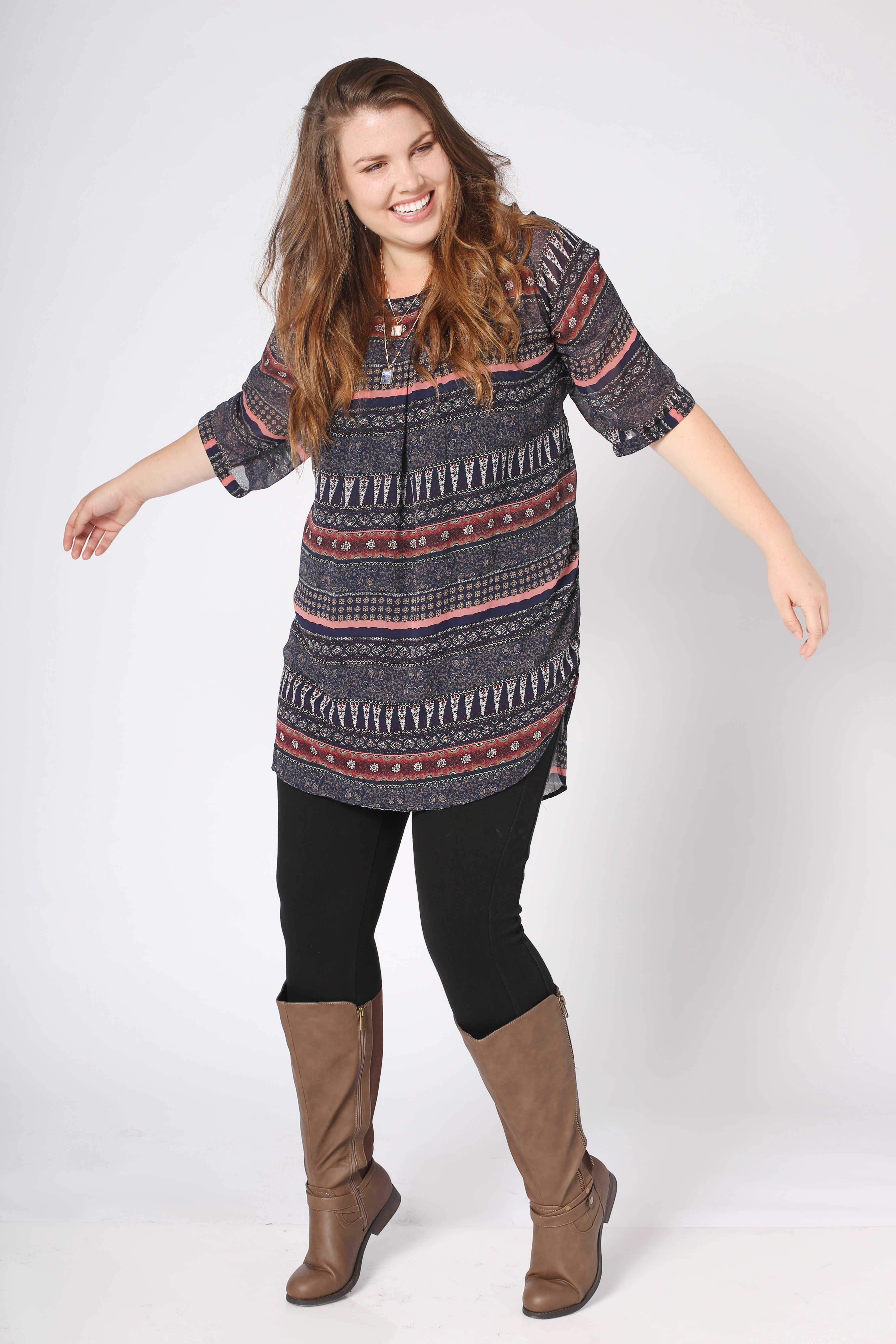 Plus Size Fashion OOTD: Pair you tunic with your favorite leggings and tall boots for the perfect fall style.