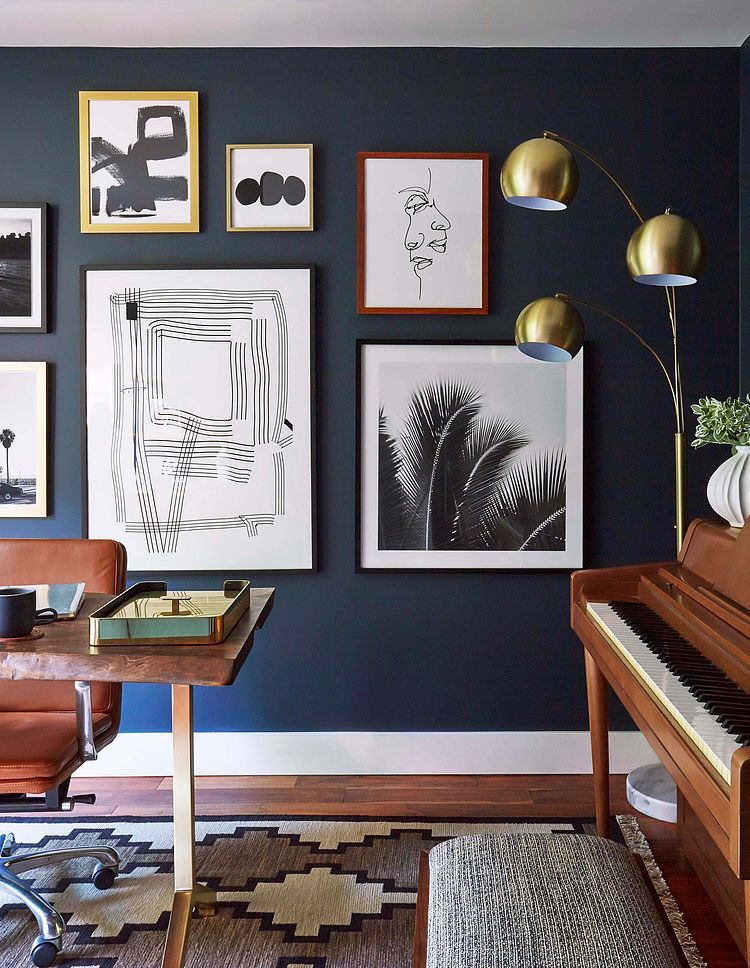 The Blue Accent Wall Contrasts With The White Wall Decorations And The Lighter Wood Tones Home Decor Home Office Decor Home Office Design