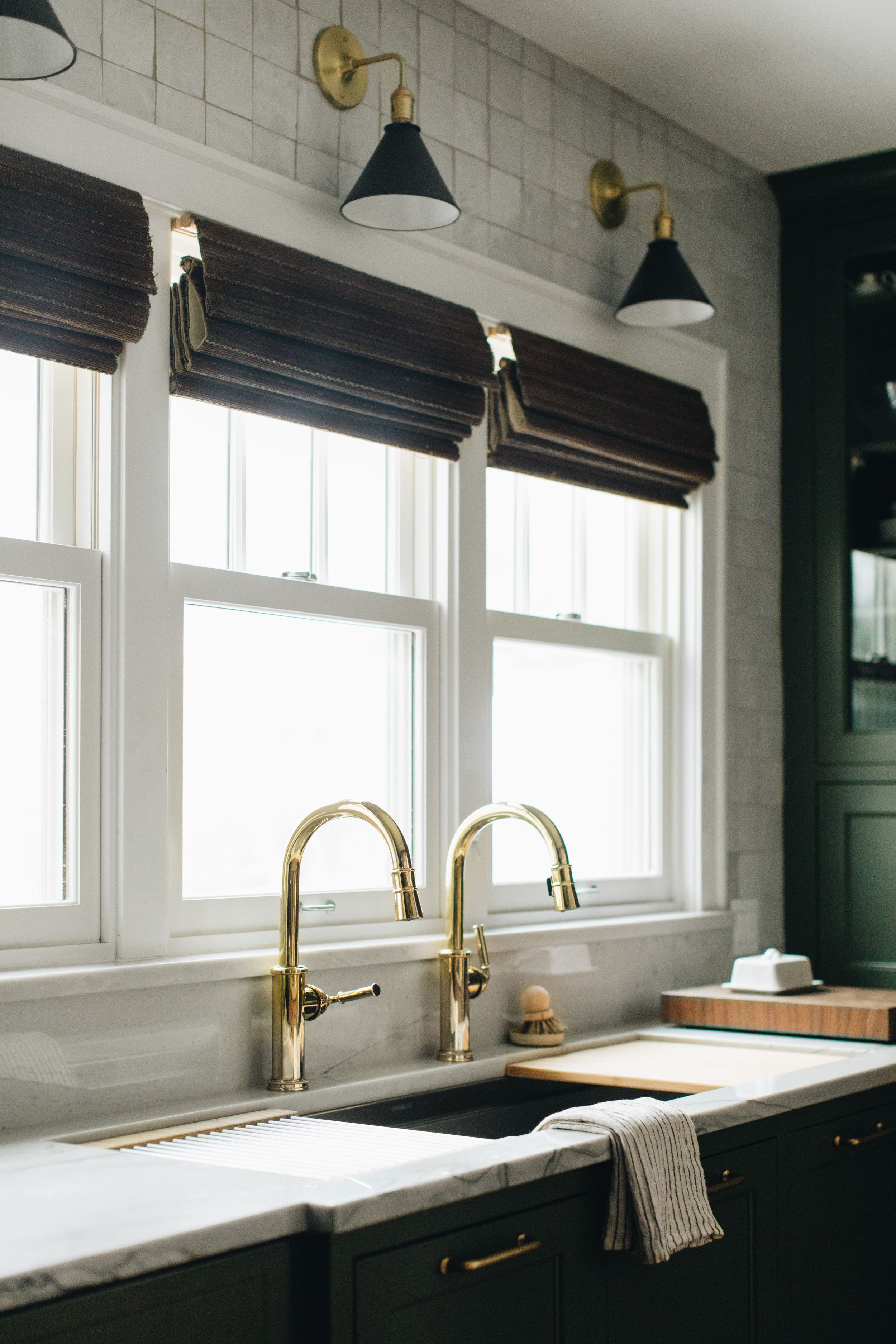 Two Faucets At One Sink Sconces Above Window Green Kitchen