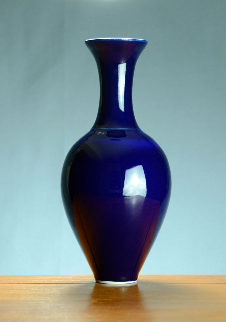 Wheel Thrown Porcelain Fluted Blue Vase With An Elegant