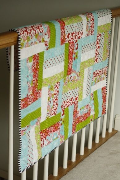 just pic  3/3/14 Jelly roll quilt: red, teal, green and pink...  Love the binding in the striped fabric.