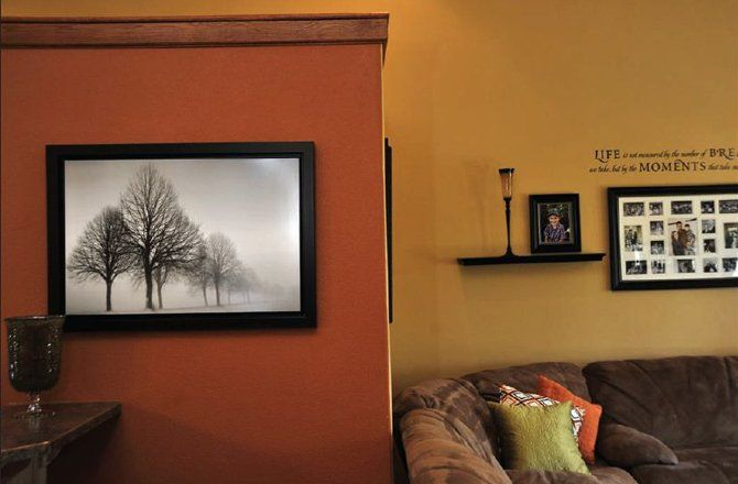 Burnt Orange Paint Color Living Room Yellow And Grey Wallpaper Accent Wall That Contrasts With The Golden Hue Of