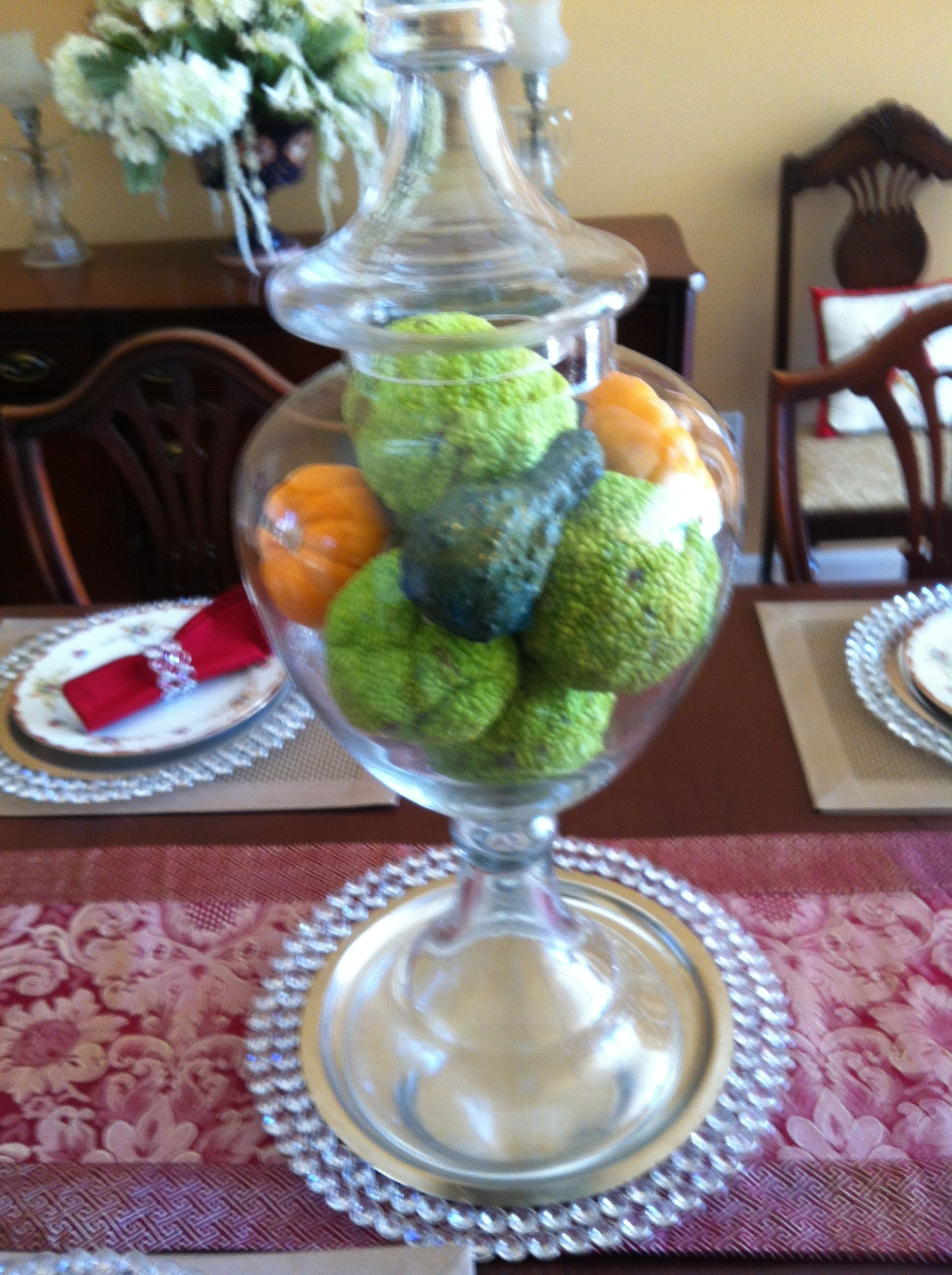 Hedge apples and pumpkins make pretty centerpiece for Fall