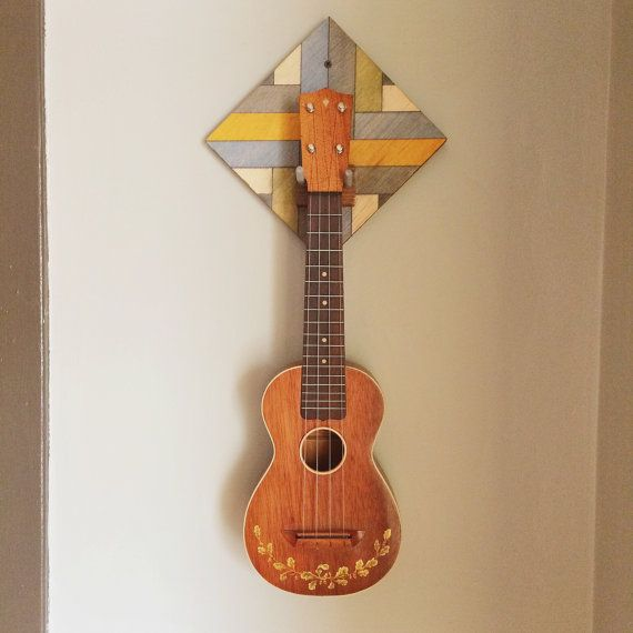 these unique ukulele wall mounts are made with recycled wood each individual holder is created. Black Bedroom Furniture Sets. Home Design Ideas