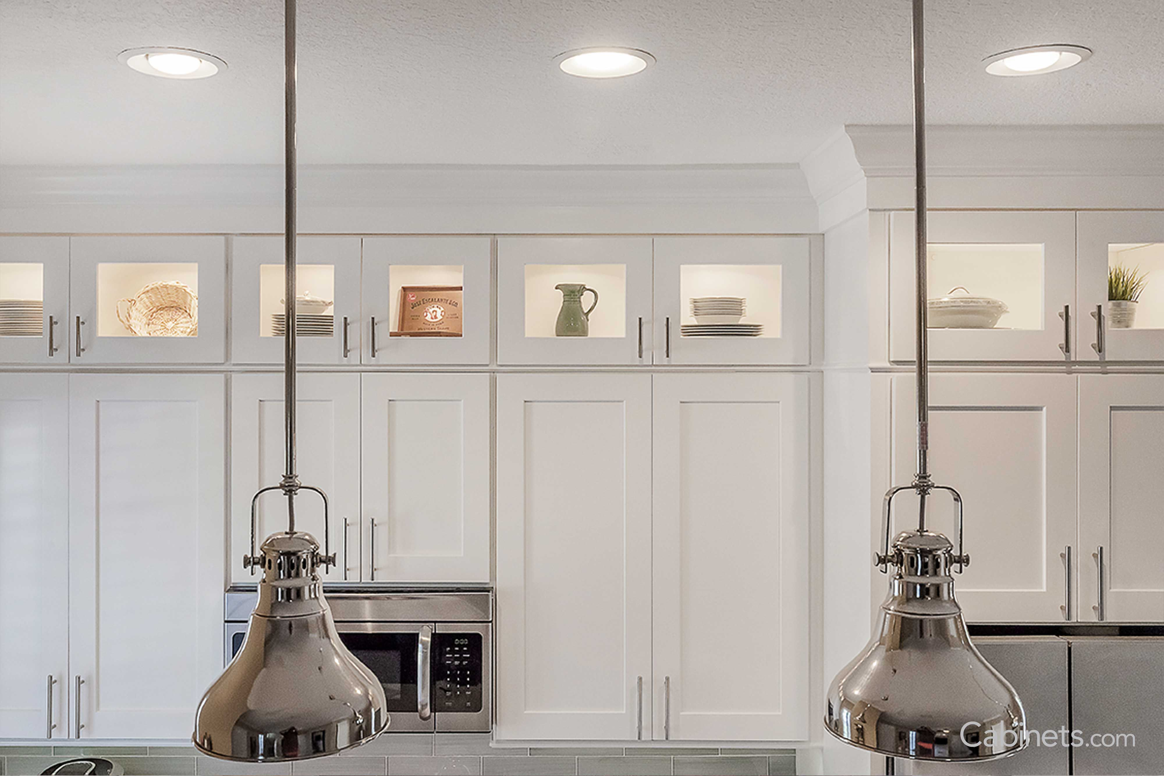 Classic White Kitchen With Subway Tile And Stacked Glass Uppers Cabinets Com In 2020 Glass Upper Kitchen Cabinets Glass Upper Cabinets White Shaker Cabinets