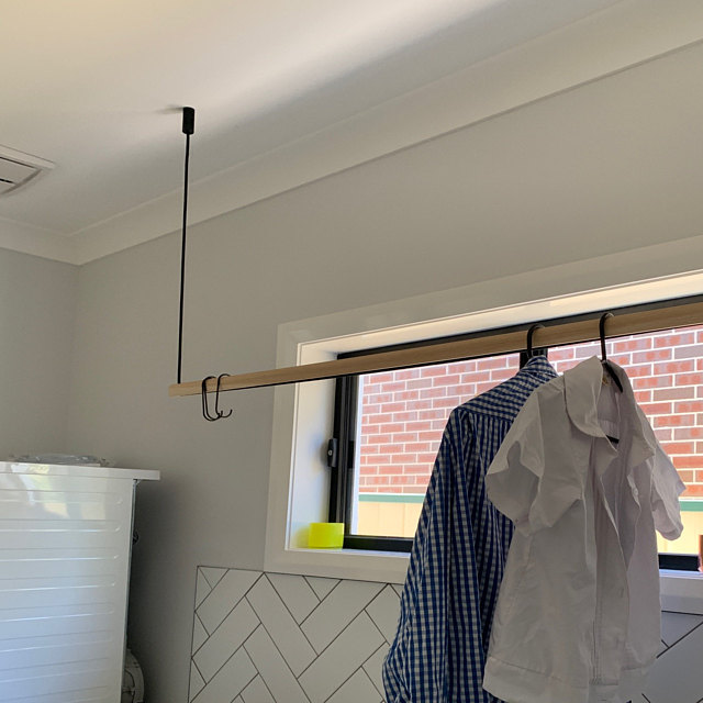 modern hanging clothes rack in black