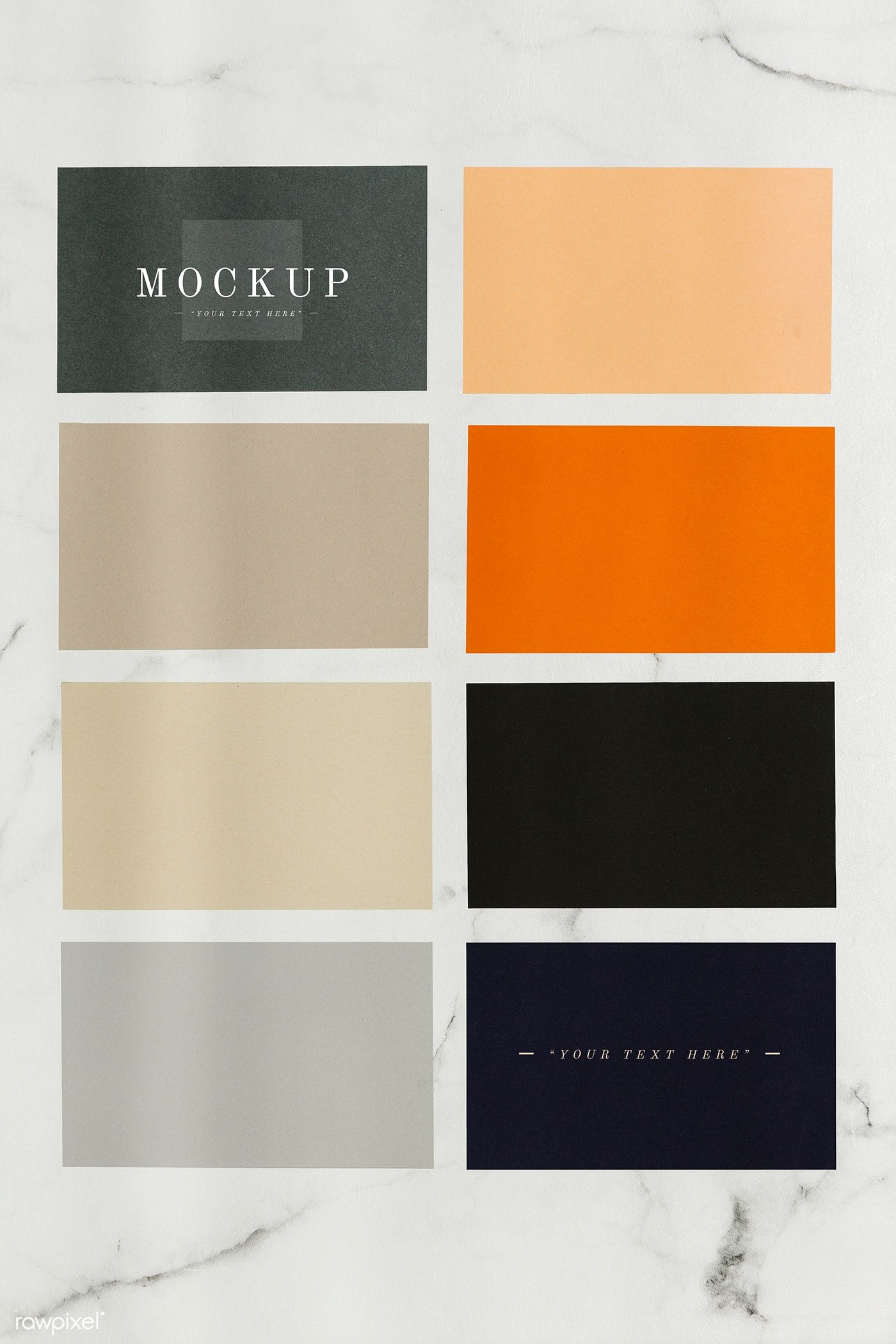 colored sample paper square mockups on a marble table