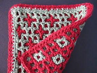 Stars & Squares Potholder - description of method for Interlocking Crochet but not a pattern on Wild Rose Fiber Studio at http://windrosefiberstudio.blogspot.com/2011/11/stars-squares.html