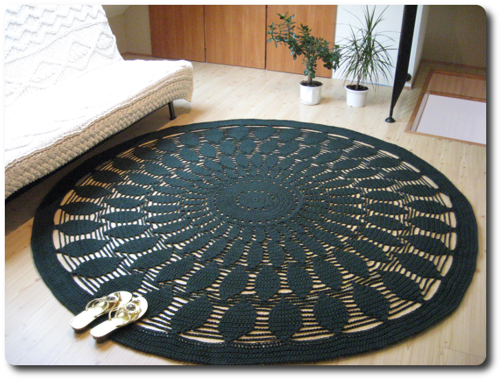 A crocheted carpet - 214 cm in diameter, 4.8 kg of weight, 2 km of cotton twine and 16 hours of hard work! I used a 6 mm crochet hook and a 3 mm cotton twine.
