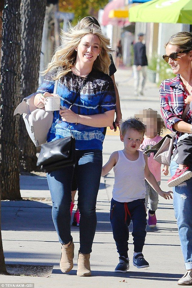 Fun in the sun: Hilary Duff and her son Luca could not be happier to be out in the sunshin...