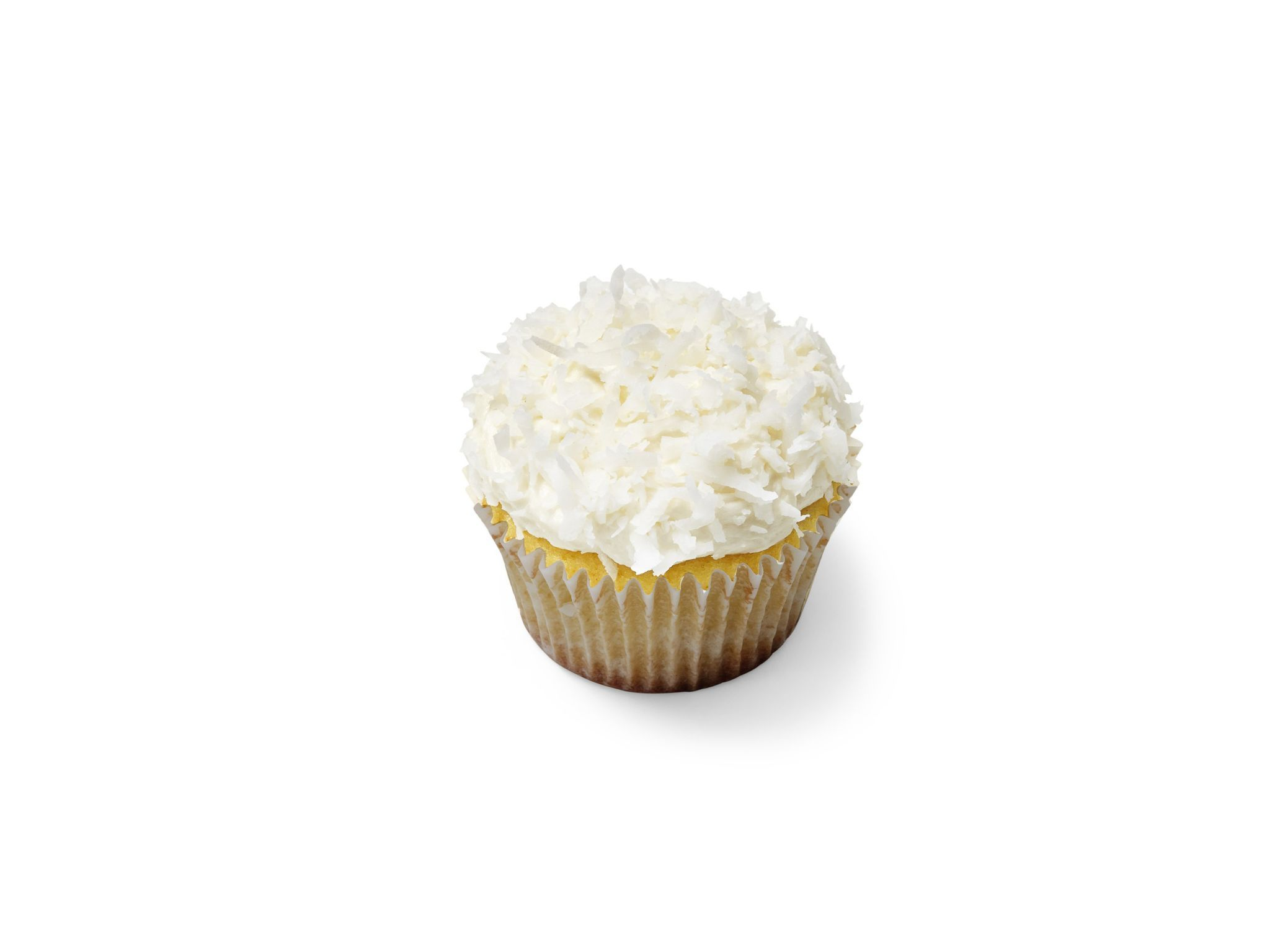 Coconut–White Chocolate (No. 13) : Make Vanilla Cupcakes, replacing the milk with unsweetened coconut milk; fold 1/2 cup white chocolate chips into the batter and bake in nonstick liners. Make Vanilla Frosting, replacing the milk with unsweetened coconut milk. Frost the cupcakes and top with shredded coconut.