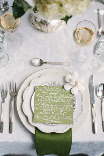 White calligraphy on green card stock