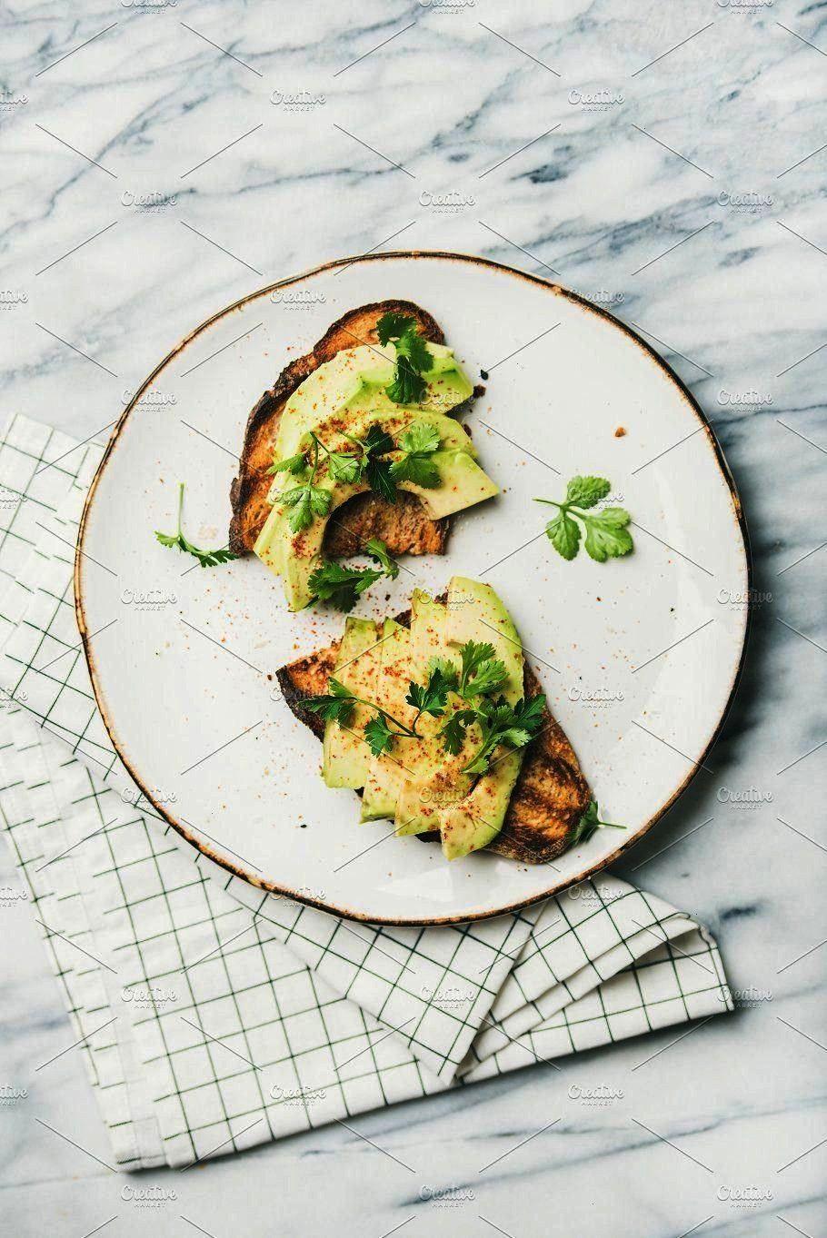avocado toast over marble background top view Healthy vegan breakfast or lunch Flatl Flatlay of avocado toast over marble background top view Healthy vegan breakfast or l...