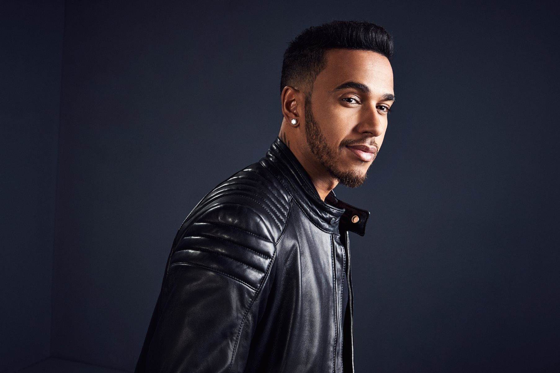 Lewis Hamilton wears a soft leather biker-inspired jacket with padded  detailing from the BOSS f715c0ff2a3