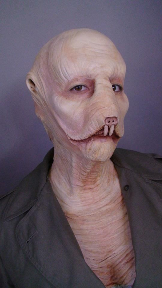 Would this be a naked mole rat? That's what I see. I can dig it ...