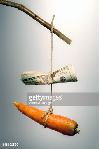 Stockfoto : Carrot and money on a stick