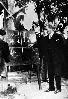 Atatürk introducing the new Turkish alphabet 20 September 1928. In the spring of 1928, Mustafa Kemal met several linguists and professors from Turkey to implement a new alphabet for the written Turkish language based on a modified Latin alphabet. The new Turkish alphabet would serve as a solution to the literacy problem in Turkey. As he predicted, the country's adaptation to the new alphabet was very quick, and literacy in Turkey jumped from 10% to over 70% within two years.
