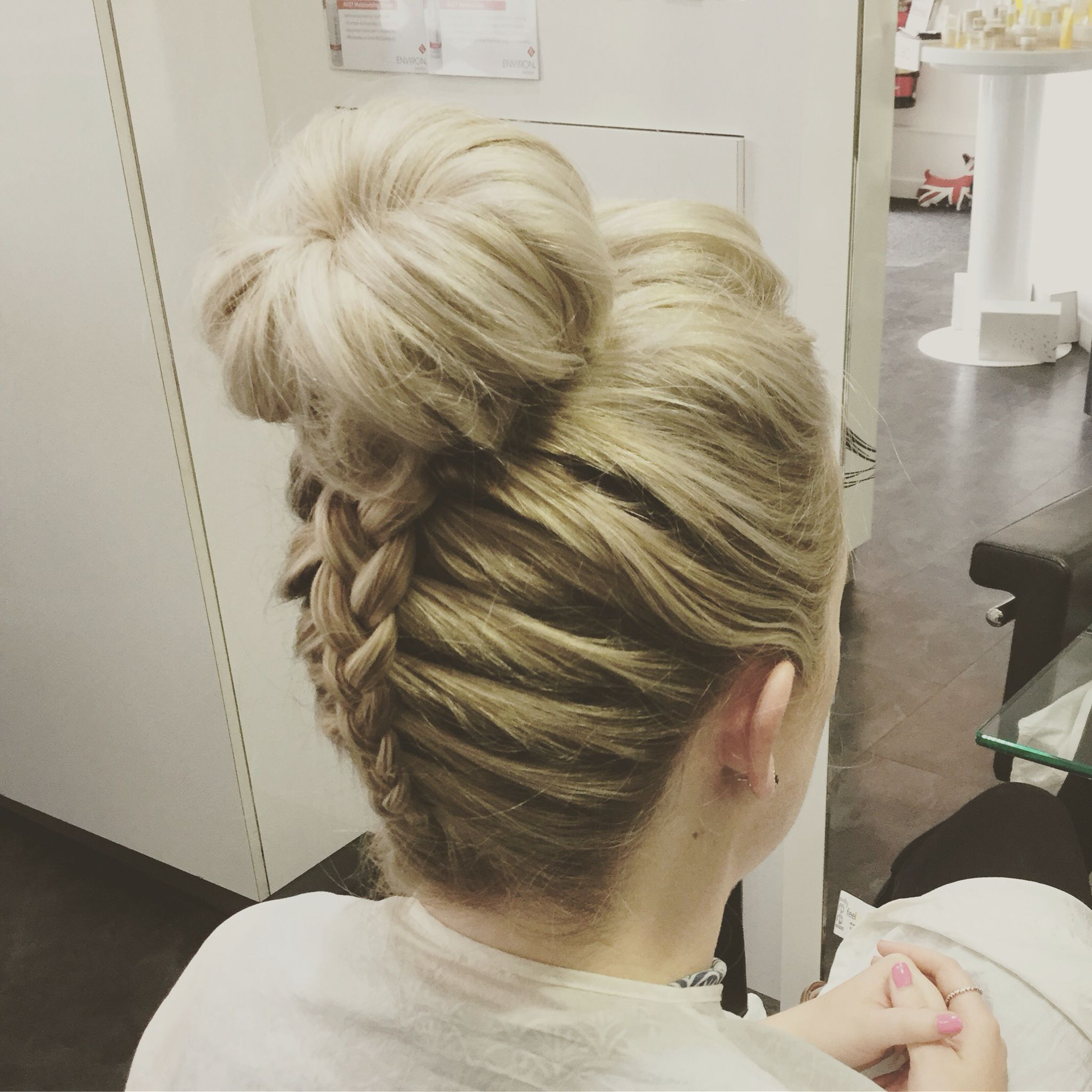 wedding guest hair up using bun and inside out plait at