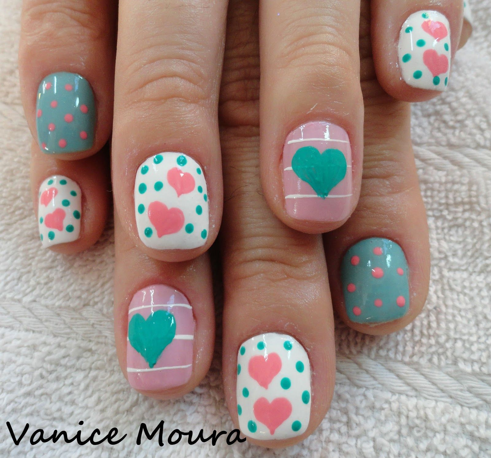 Pink, white and blue nail art with hearts, lines and polka dots ...