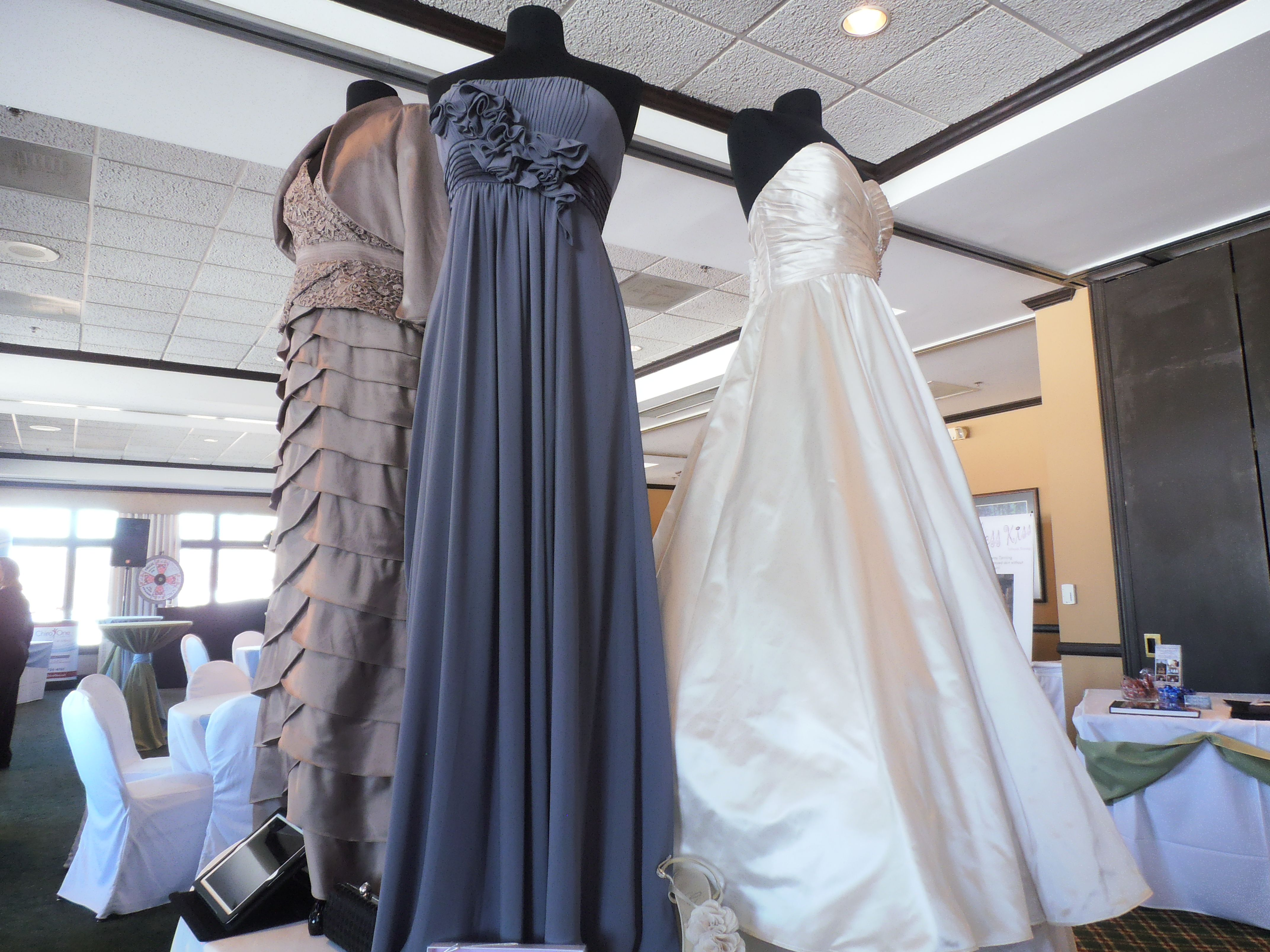 Bridal show gowns and tuxedo samples were provided by bella bridal