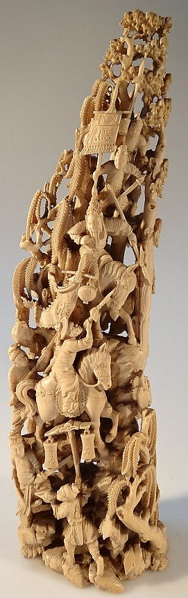 An exceptional and finely carved Chinese ivory tusk, depicting warriors on horseback, standard bearers, various script markings, 19thC, 35cm high.