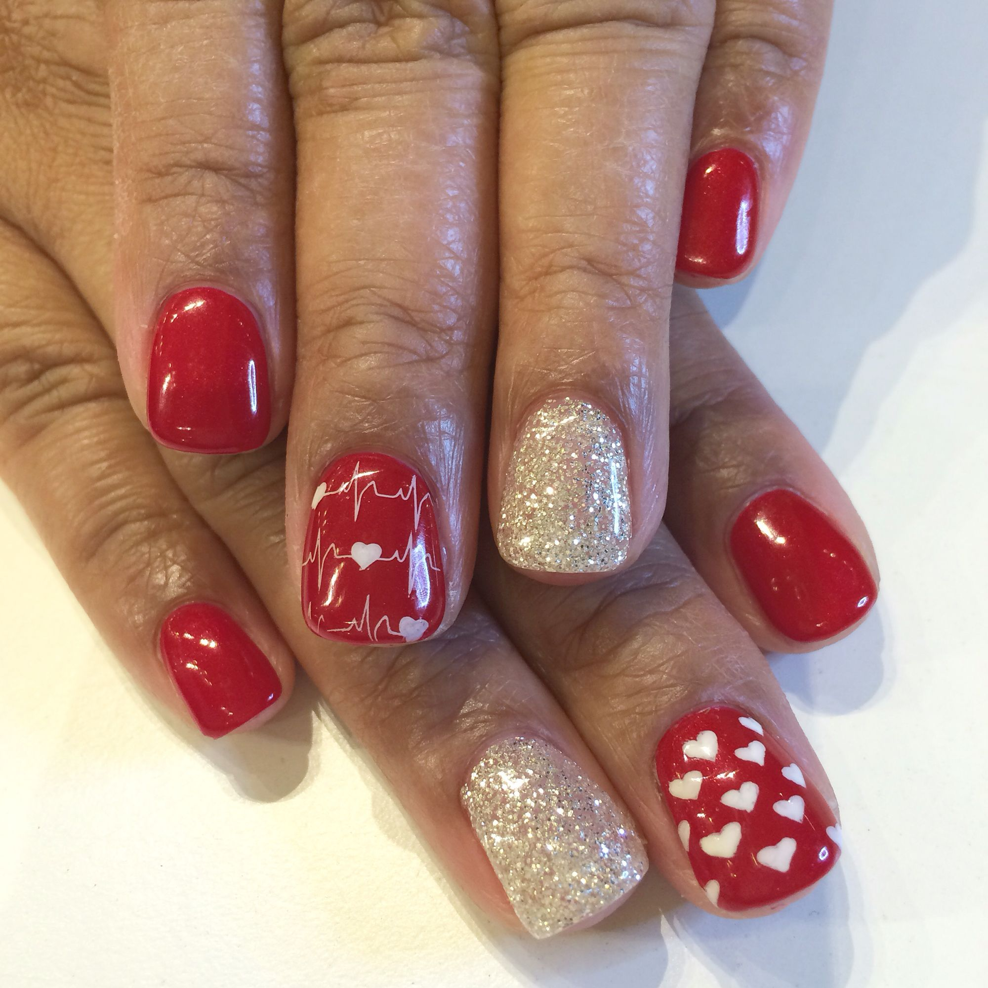 Valentine\'s Day nail design with hearts and heartbeat stamps. Bio ...