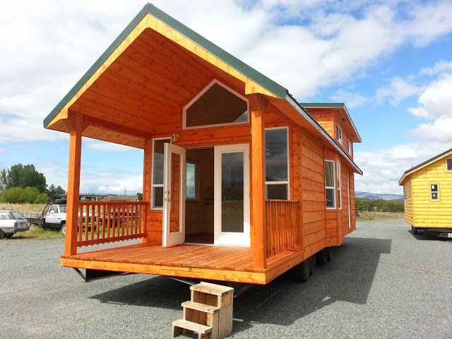 This is the Pacific Loft Tiny House on Wheels by Rich's Portable Cabins. It's a 399 sq. ft. park model tiny home that's about 40′ long (including the 7′ porch). Please…