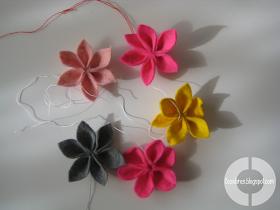Cute felt flowers would make a nice garland