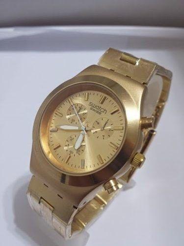 90d66cf70c14 reloj swatch dorado unisex