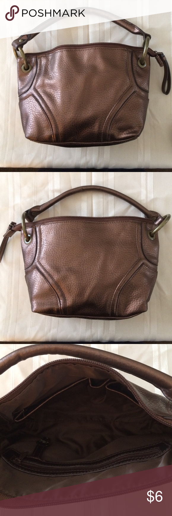 """SMALL CLUTCH BAG BRONZE COLOR Nice small bag bronze color with large polished gold ring and tab accents. Two pouches and a zippered pocket inside.  Size 11x7"""" depth 3"""". 100% PVC material. In very good condition. Willing to bundle items. Smoke and pet free house. Bags Clutches & Wristlets"""