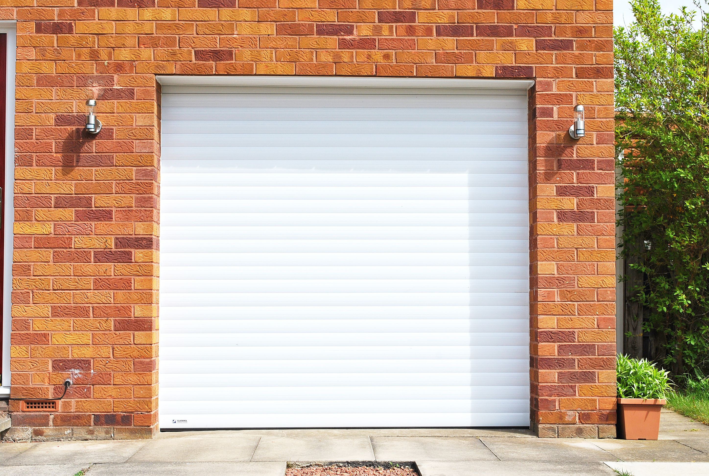 A Beautiful White Gliderol Garage Door Supplied And Fitted By Us At