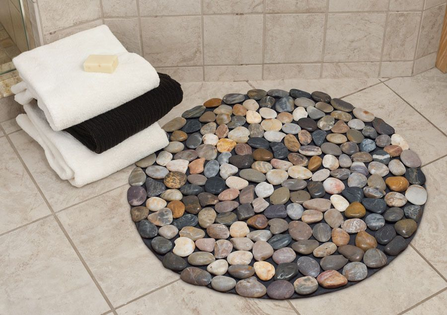 Bright Bathroom With Tile Flooring Containing Circular Pebble