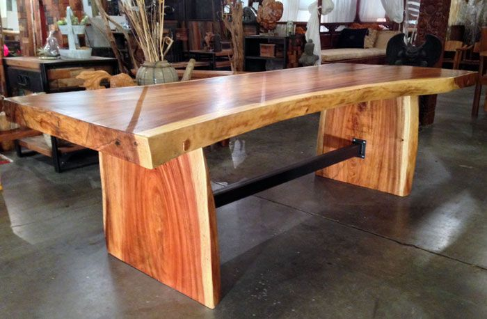 a large live edge monkeypod wood slab dining table with custom steel trestle between the natural - Stone Slab Dining Room Decorating
