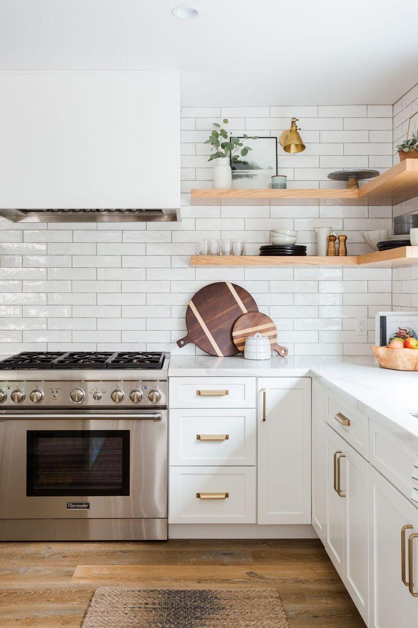 West Coast Style Defined Rue White Subway Tile Backsplash Stainless Steel Appliances White Kitchen Kitchen Design New Kitchen Cabinets Kitchen Renovation
