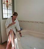 Preparing for a whirlpool bath.