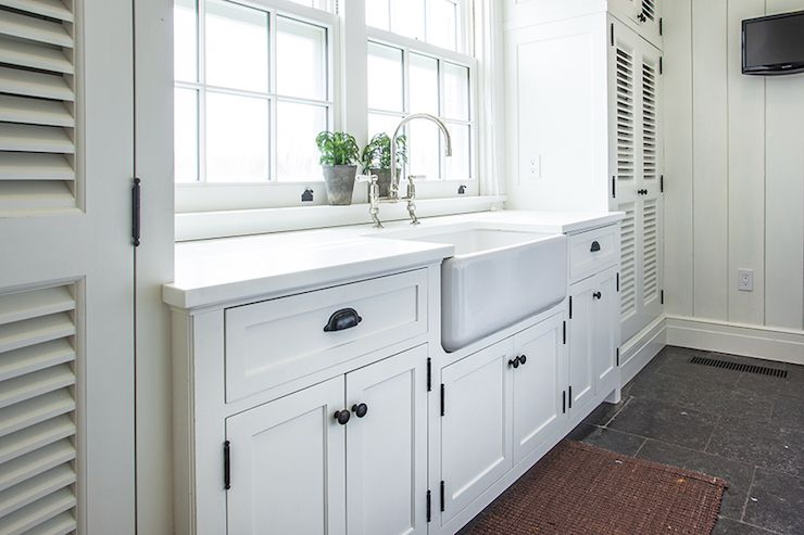 Cottage laundry room features white shaker cabinets for White kitchen cabinets with oil rubbed bronze hardware