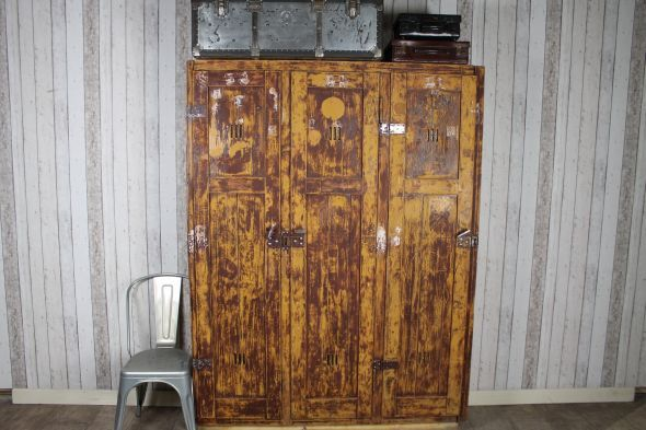A great shabby chic piece of furniture, this lovely industrial looking pine industrial set features iron hinges and handles, and has a lovely distressed...