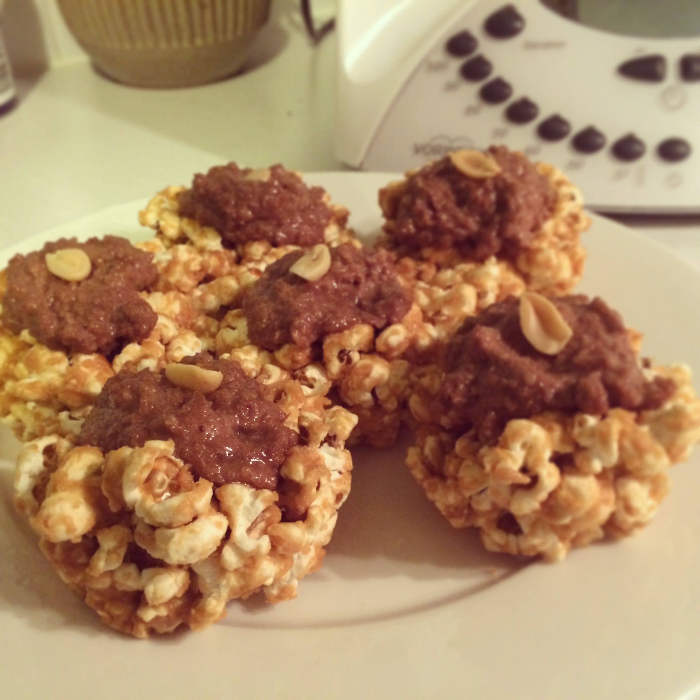 Raw peanut butter popcorn and cacao cream cups