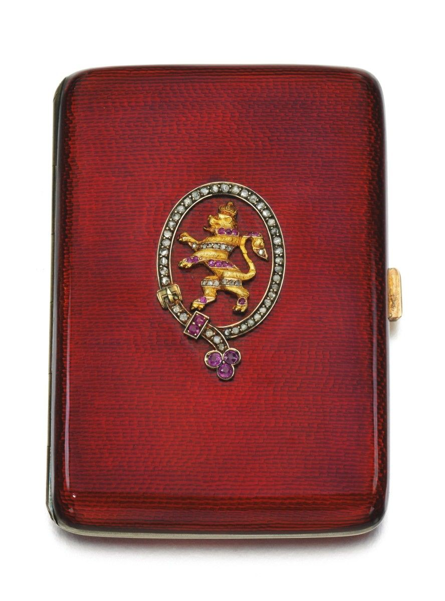 Duchess of Windsor -SILVER AND ENAMEL CIGARETTE CASE, GERMAN, EARLY 20TH CENTURY, The front applied with a jewelled crest depicting a gold heraldic lion rampant, crowned within a rose-diamond and ruby garter, enamelled in translucent scarlet on a textured ground, apparently unmarked, in a blue velvet case gilt with a royal crown.