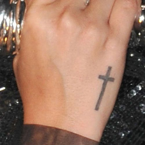 Demi Lovato Cross Side of Hand Tattoo | Steal Her Style