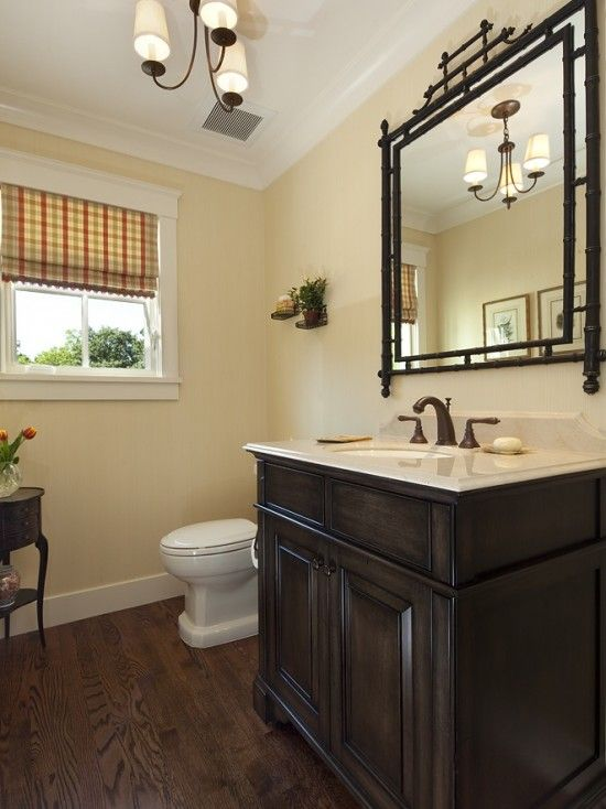 Pretty half bath like the light fixture and dark wood for Dark wood bathroom designs