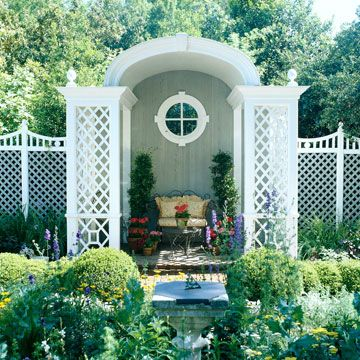 Backyard Landscaping Ideas Garden Structures:   Enhance your outdoor living spaces with beautiful garden structures. Pergolas and arbors can change the way you look at your yard. Latticework-Decorated Garden Seating  A bold archway with lattice sides creates a grand seating area, which is on a raised platform and decked out with a cushioned love seat and potted plants. A window inset in the back of the structure adds a sense of depth.