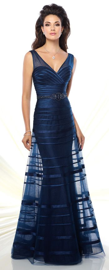 8e09d940532 This sleeveless tulle and satin slim A-line gown features front and back  illusion V