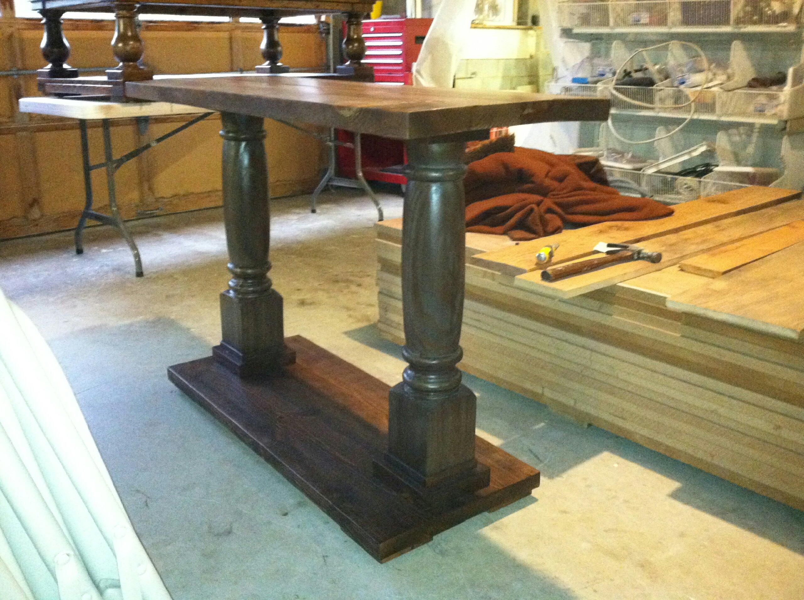 This is a solid wood frame and top sofa table with turned post and ...