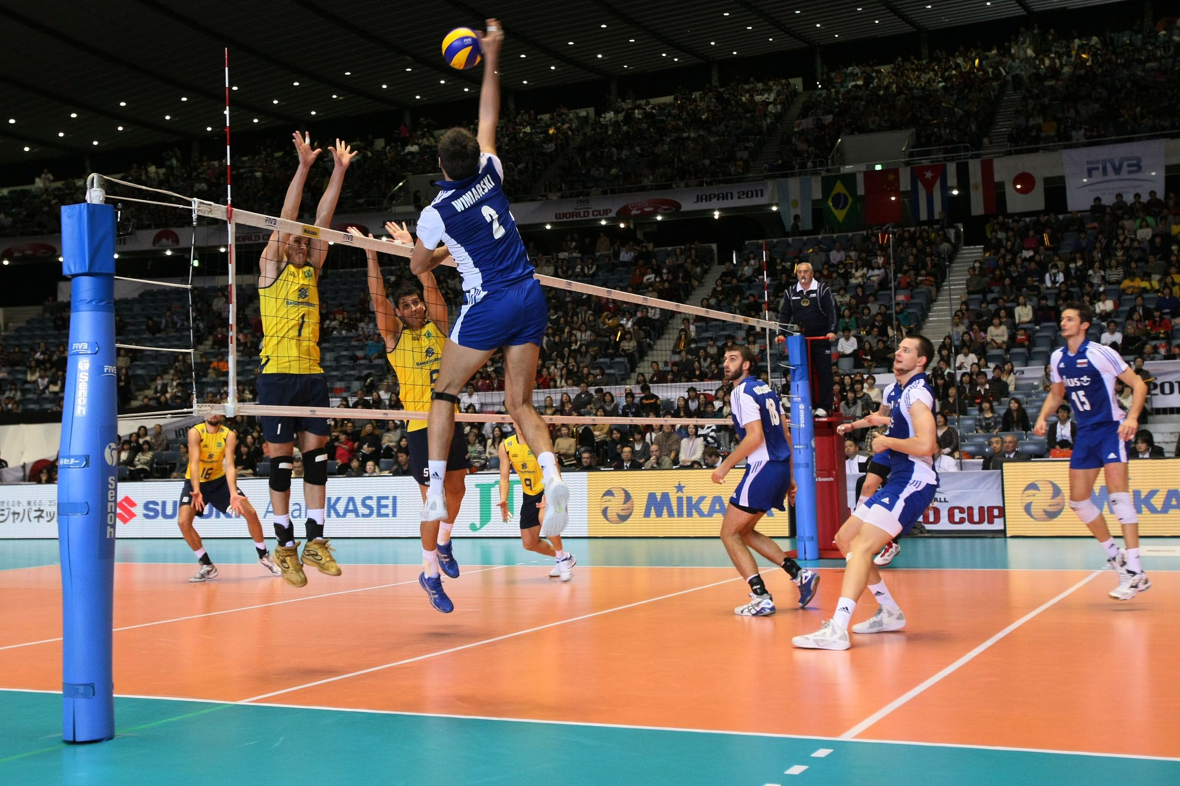 Michal Winiarski Spikes For Poland With A One Man Block For Brazil Volleyball Brazil Poland